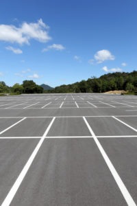Signs Your Commercial Concrete Parking Lot Needs Repair or Demolition